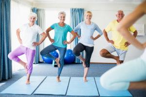 Older people balancing on one leg