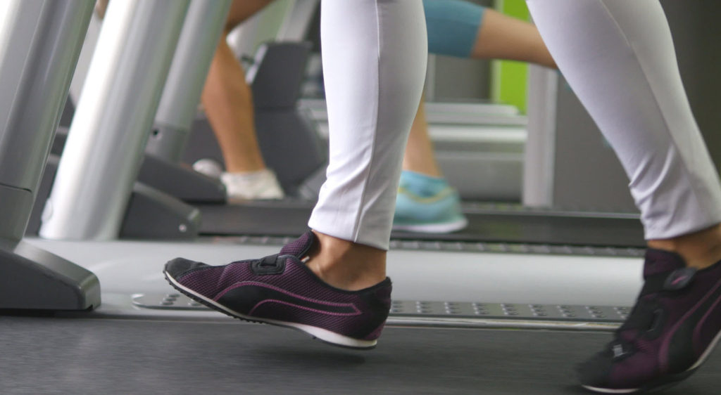 Walking on treadmill - heel about to hit ground