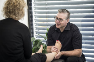 Foot mobilisation therapy being applied to clients feet