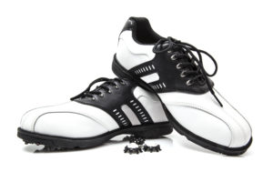 Golf shoes with spare spikes